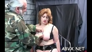 Nude lady is sitting on her sextoy