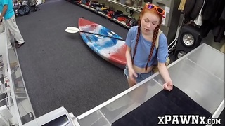Little redhead temptress earns money by fucking in pawnshop