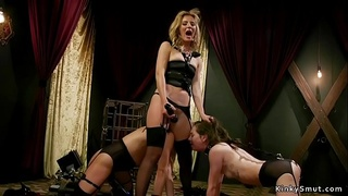 Mistress whips and fucks two lesbians