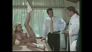 Naughty blonde cheerleaders Allysin Chaynes and Julie Meadows take part in special experiment with handsome doctor