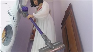 what a naughty housewife! all naked and struggling with the vacuum cleaner