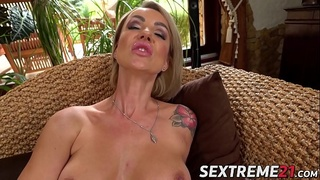 Big titted MILF toys her ass before riding massive dick