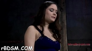 Bounded slave girl is getting a lusty slit punishment