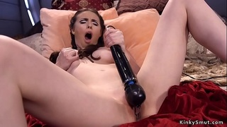 Spreaded legs babe takes machine up her ass