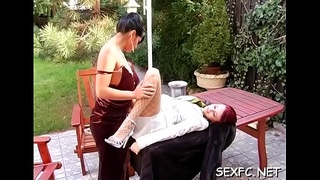 Fully clothed female works 10-pounder in the pussy like a femdom-goddess