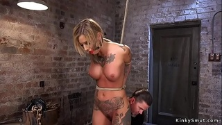 Alt busty blonde in strict hogtie suspension