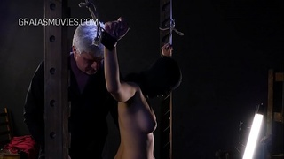 Masked whore whipped while giving a blowjob