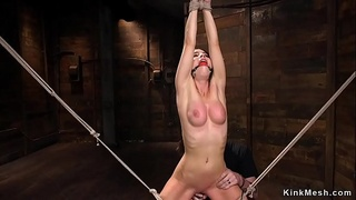 Brunette gets hot wax and pussy toyed