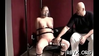 Busty sweetheart gets ballgaged and aroused while being belted