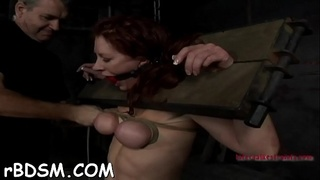 Restrained playgirl receives wild toy drilling for her twat