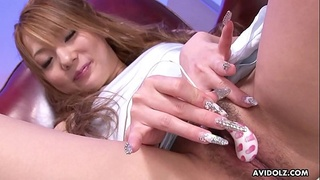 Delightful Japanese fuck doll is playing with a mini vibrator