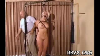 Breasty cutie gets greatly horny while being bounded tight