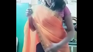 Swathi naidu sexy and romantic seducing in orange saree