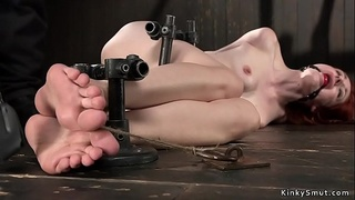 Submissive redhead tormented in device