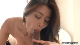 Sexy Japanese babe gives head and takes it from behind