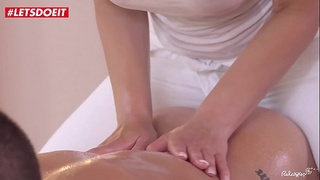 Hot Busty masseuse gives massage to her cousin