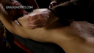 Young maiden body covered in candle wax