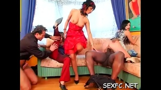 Slutty babes keep garments on as they get big cock therapy