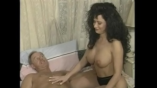 Curly haired whore with enormous bombs enjoys fucking from the ass