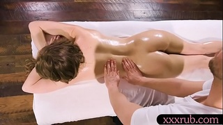 Brunette woman sucks off and hammered on massage table