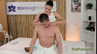 Brunette masseuse oiled fucking customer on a table