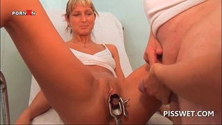 Cunt toyed blonde gets piss shot in her pussy hole