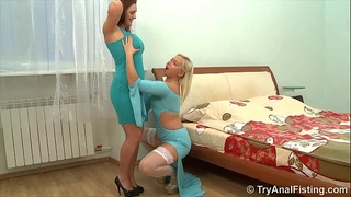 Deep anal fisting from a lesbian in white holdup stockings