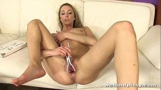 Pissplay in Bikini with a wet speculum