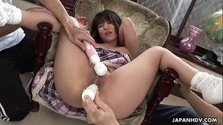 Brunette Asian babe in a chair toy fucked